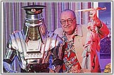 Forrest J Ackerman, the number one Science Fiction Fanman is shown here wearing a Red Jungle Bird  shirt.
